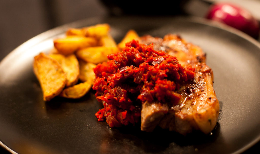 Pork chops with warm red pepper chutney